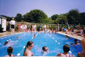 Headmaster Tony Bishop running the school swimming sports 1993